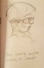 A drawing of John in swim goggles, probably 6 or 7 years old.
